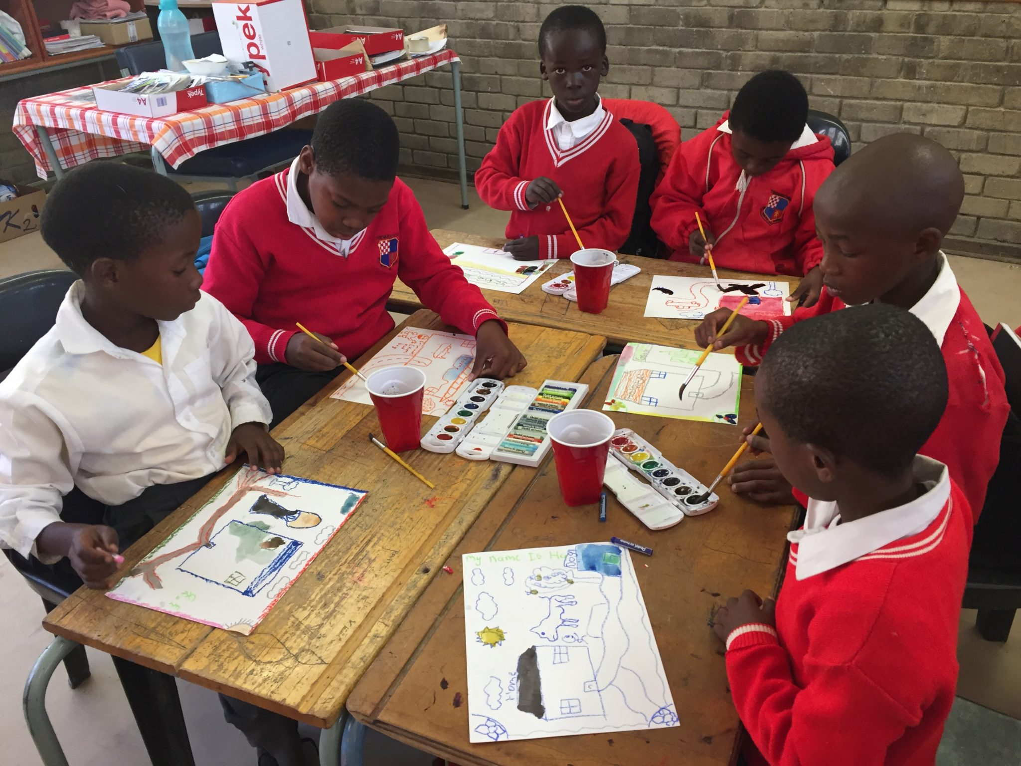 Students painting at Tshwara Thebe school