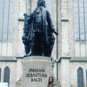 Angela Lamar standing next to a statue of Johann Sebastian Bach