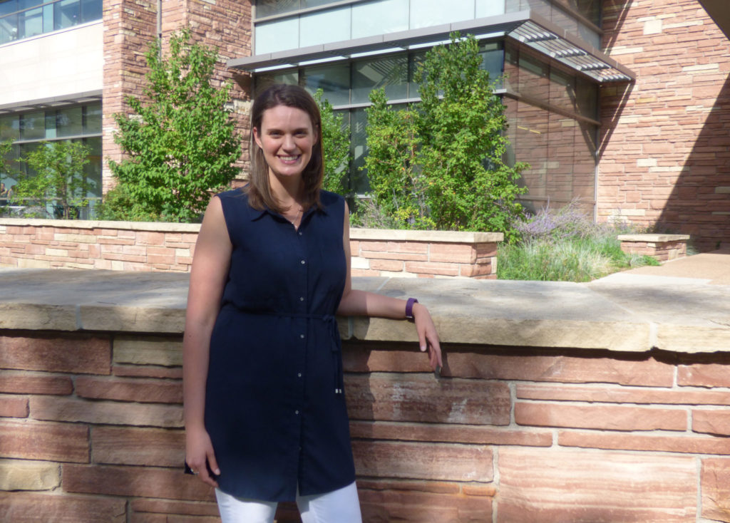Dr. Meara Faw posing outside the Behavioral Sciences Building