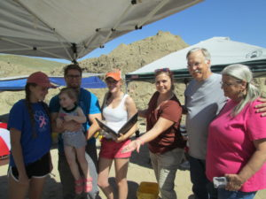 Carson Black and her family members hold the Clovis point