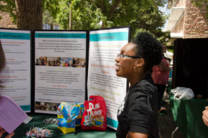 Student  promotes the new Women's and Gender Studies bachelor at the CSU Street Fair