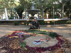 Sandy Ceas posing by her community art piece in Olot, Spain.