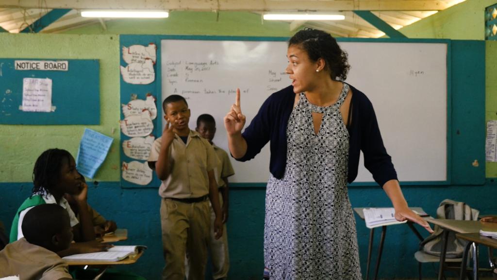 Myanne Hamm teaches Jamacian school children hopscotch.
