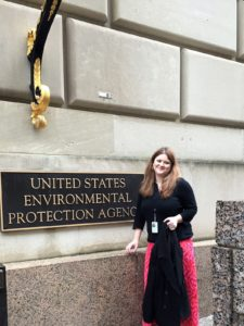Susan Opp posing outside of the Environmental Protection Agency on a trip to Washington, D.C.