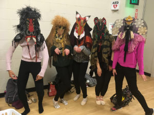 Dancers wearing masks created for The Magic Flute at CSU
