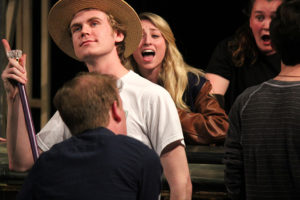 theatre students rehearse a song from the show