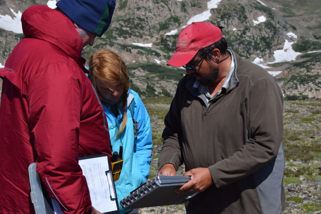 Associate Professor Jason LaBelle with students Alyssa Axe and Ray Sumner at Rollins Pass