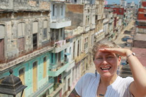 Anna taking a selfie with the streets of Cuba behind her