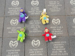 Dr. Jianakoplos' keychain Teletubbies laid down next to the brick in their name at the CSU Stadium