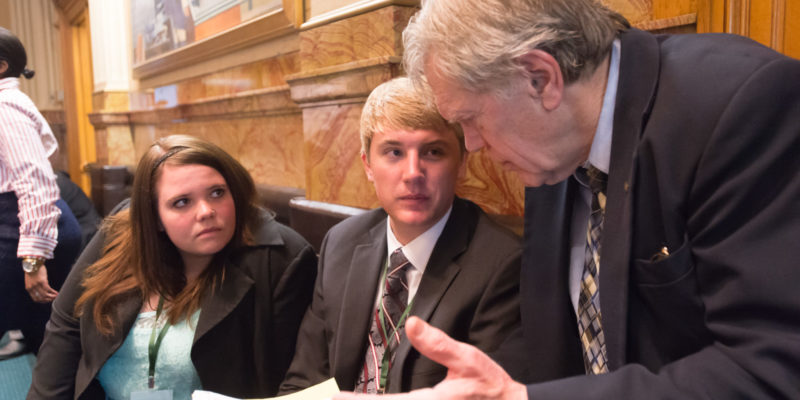 CSU Political Science Professor John Straayer working with students during the Legislative Internship Program.