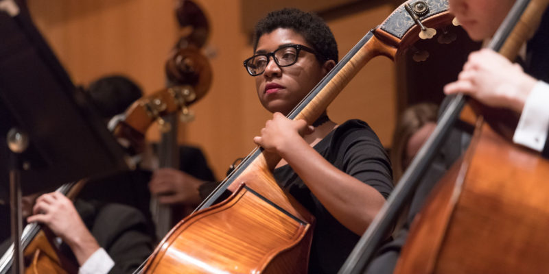 Zuri playing cello