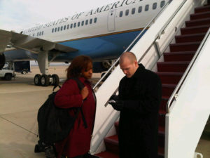 Dana Hughes and security personnel outside Air Force One