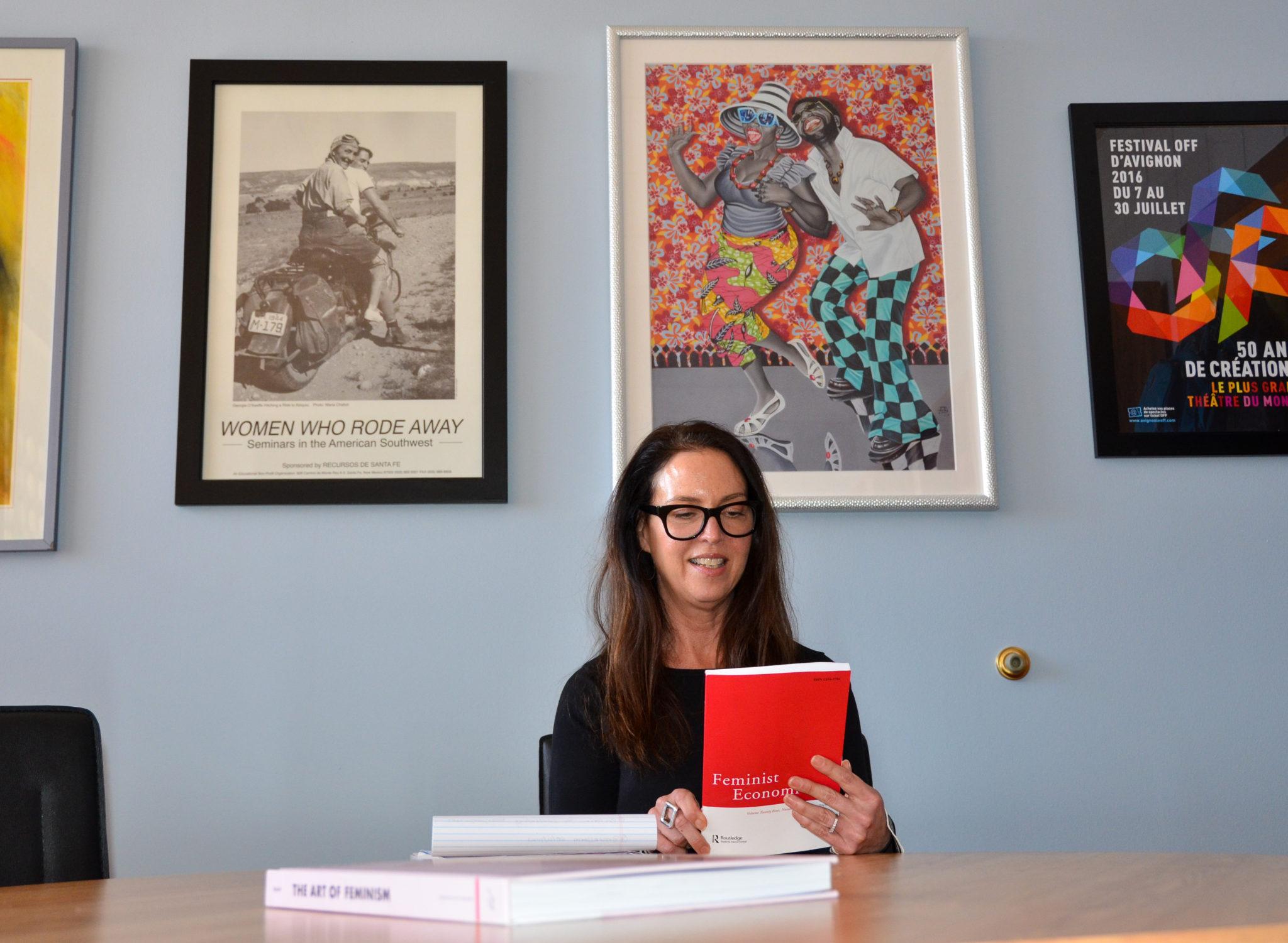 Elissa Braunstein examining the Feminist Economics Journal