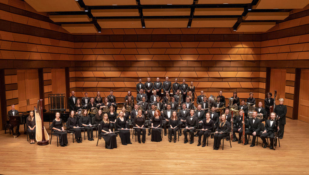 Wind Symphony sitting on stage in Griffin Concert Hall