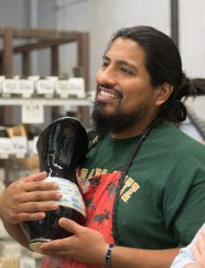 Saxon Martinez holding a pot