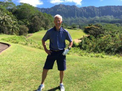 Emeritus professor Dan Tyler playing golf in Hawaii