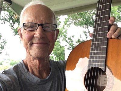 Emeritus professor Dan Tyler with his guitar