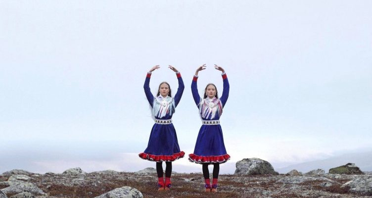 two sami dancers with arms overhead on Norwegian Lapland