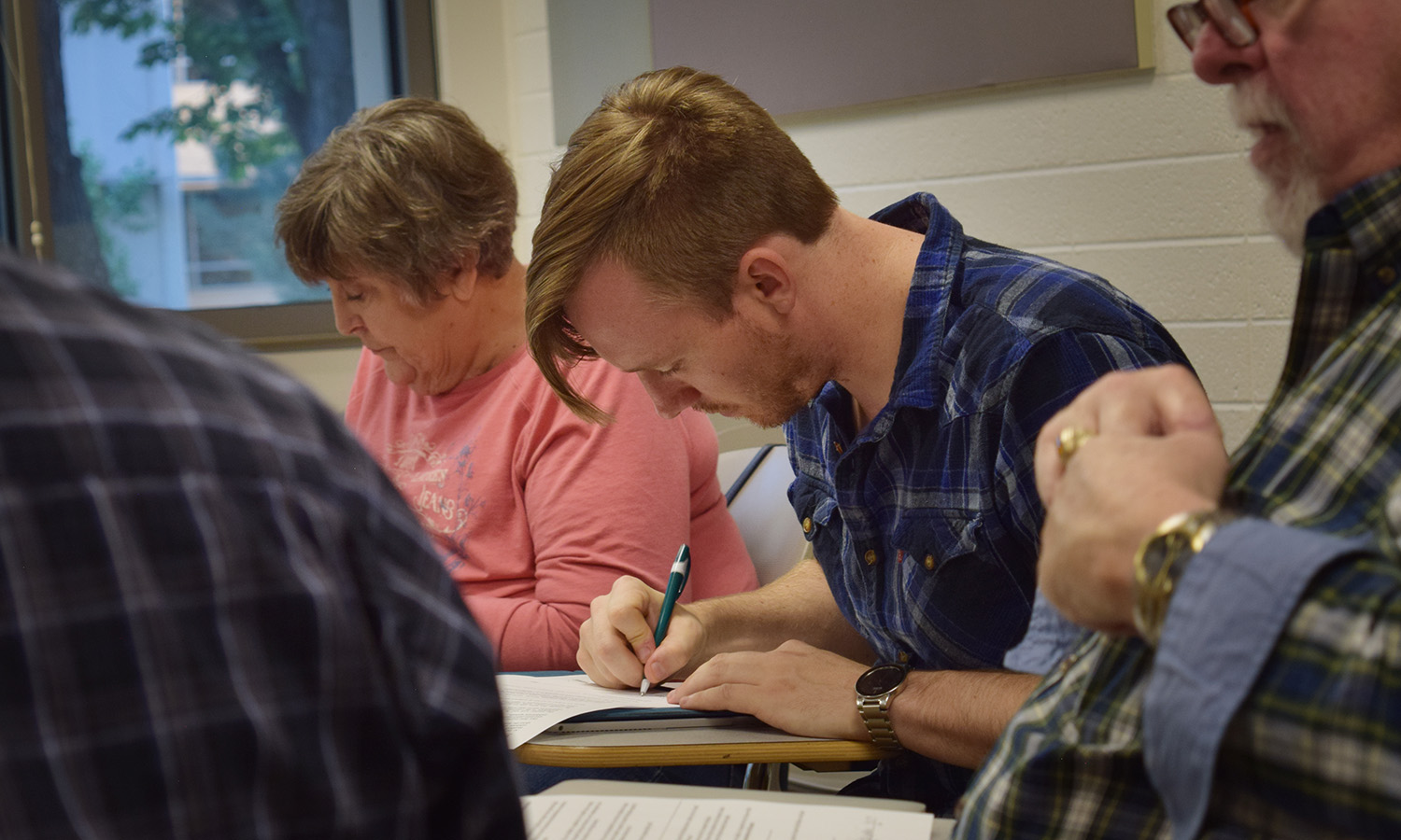 Veterans participating in writing workshop