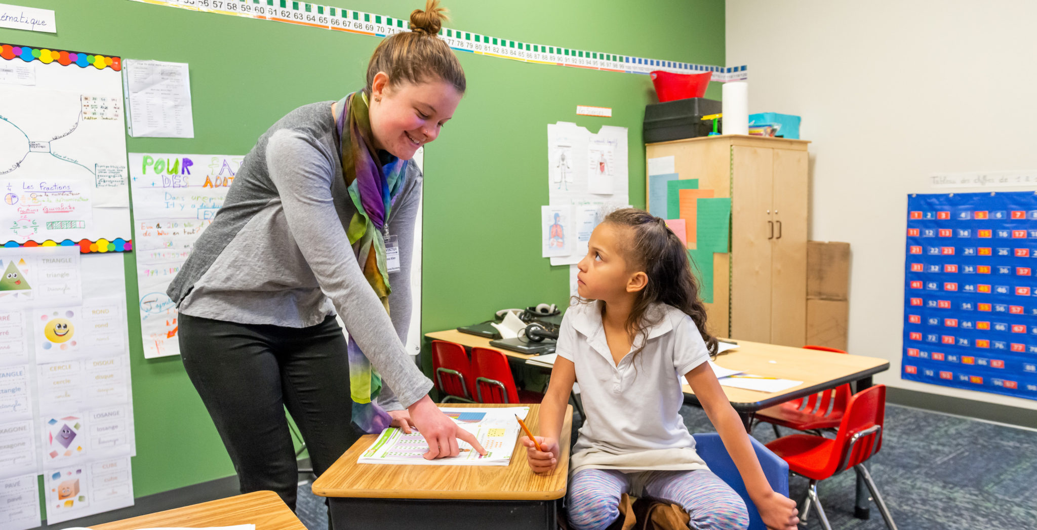 Grace Russell helps a student