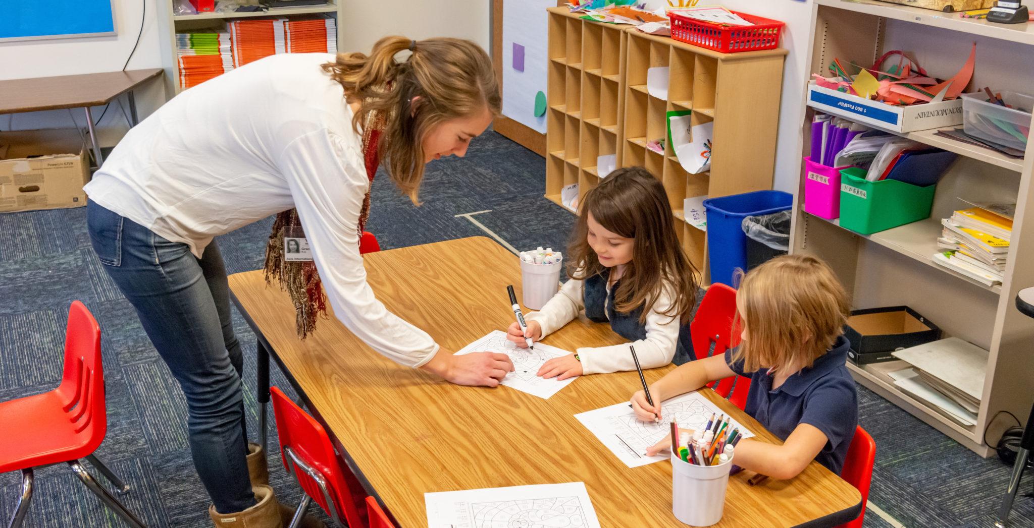 Alissa Allen helps a student