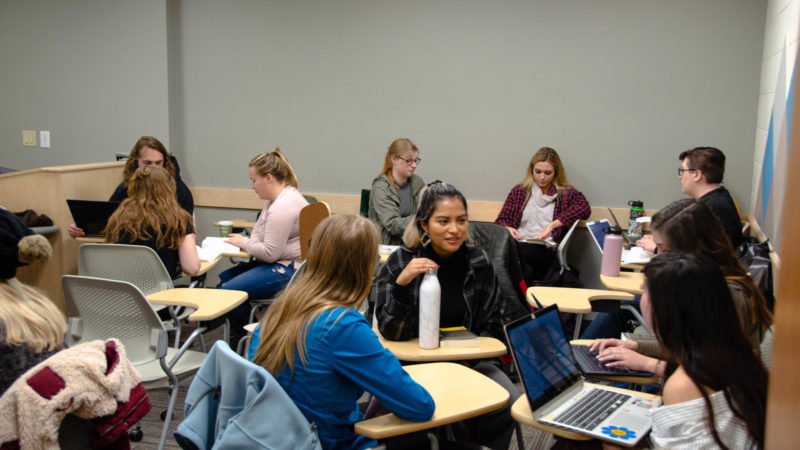 Students break into small literature discussion groups
