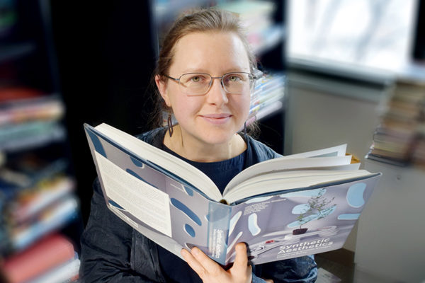 Erika Szymanski with book from above