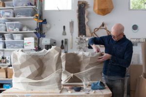In his studio, Del Harrow hand builds clay vessels that utilize texture from digital models.