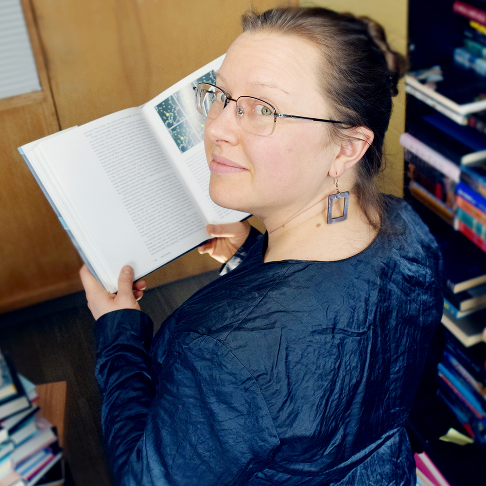 Erika Szymanski with book
