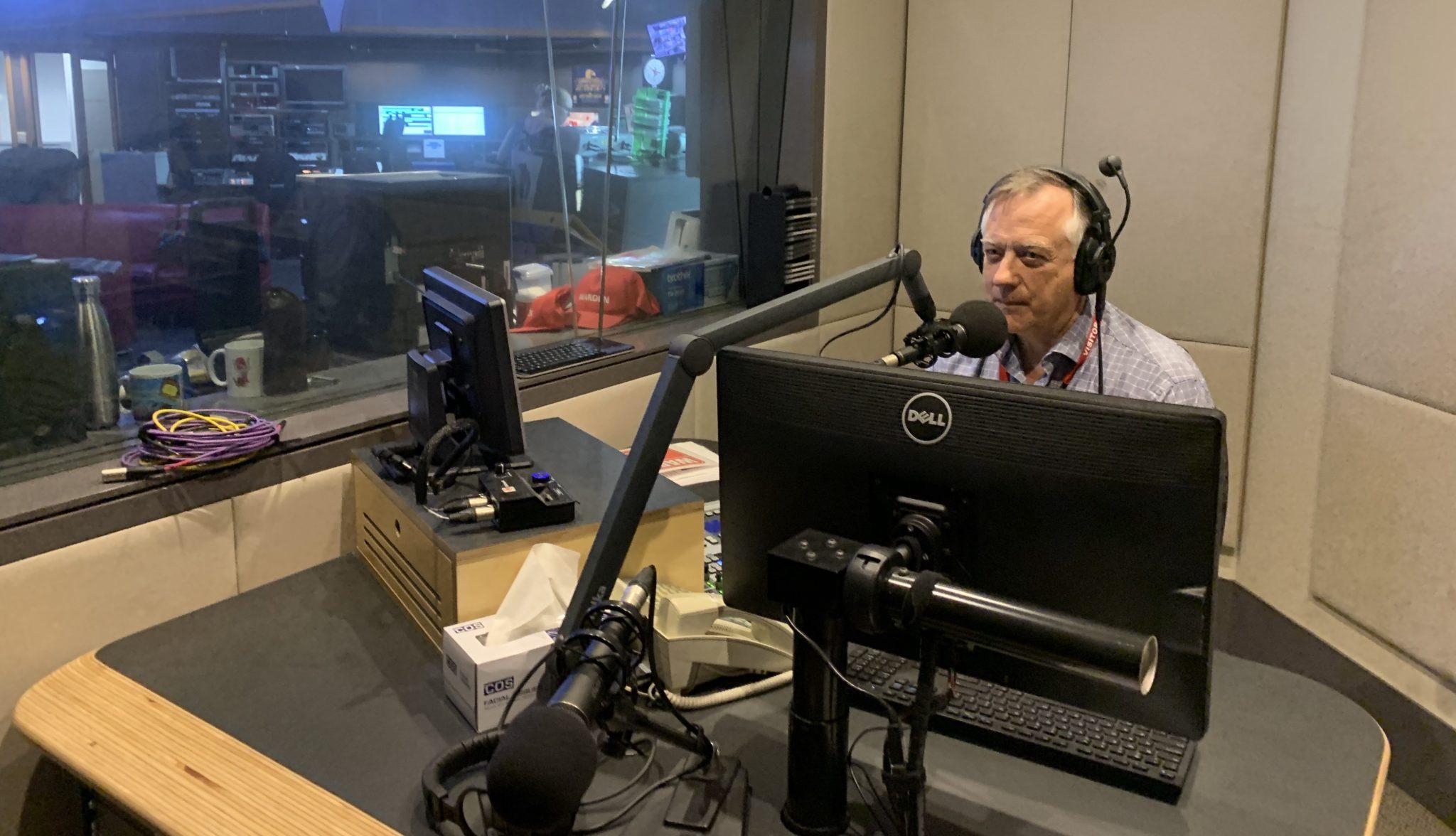 Barbier doing radio interview
