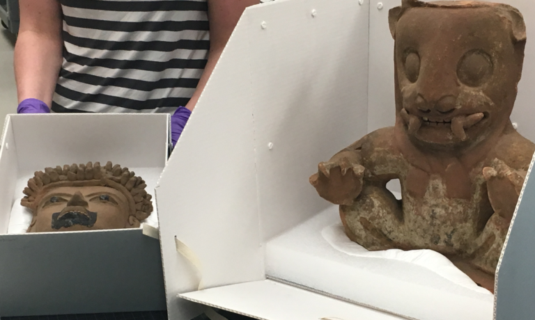 Student pulls out ancient artwork and sculptures