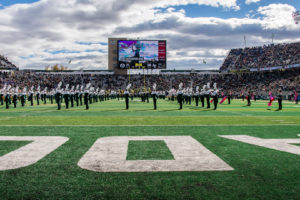 Marching band on the field at CSU Canvas Stadium