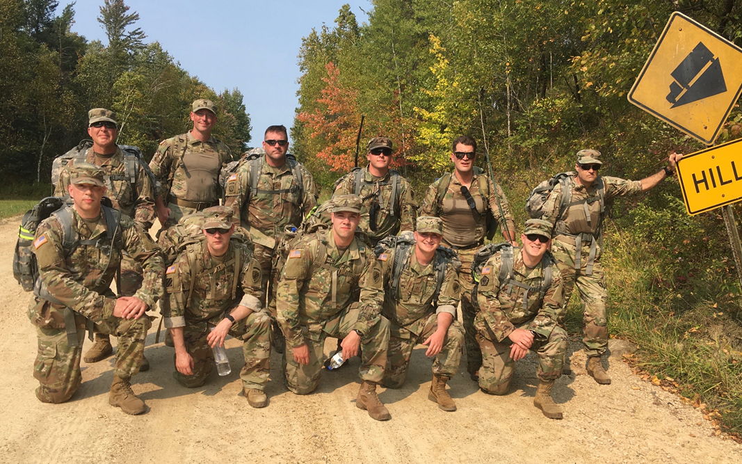 Military unit posing on dirt road