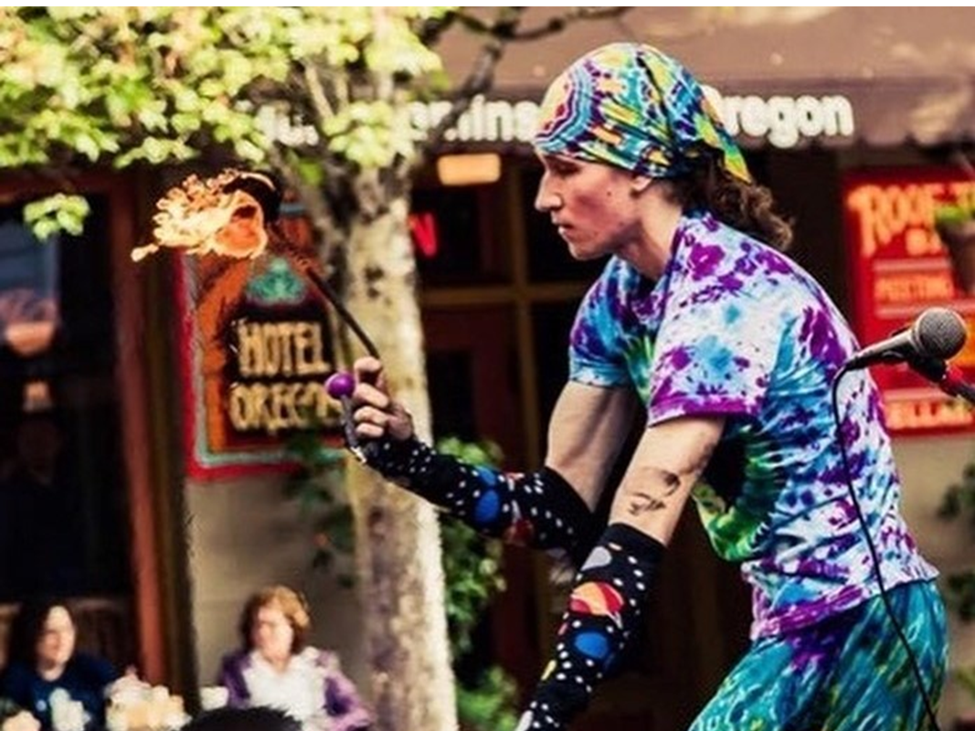 Fire performer in tie dyed clothing