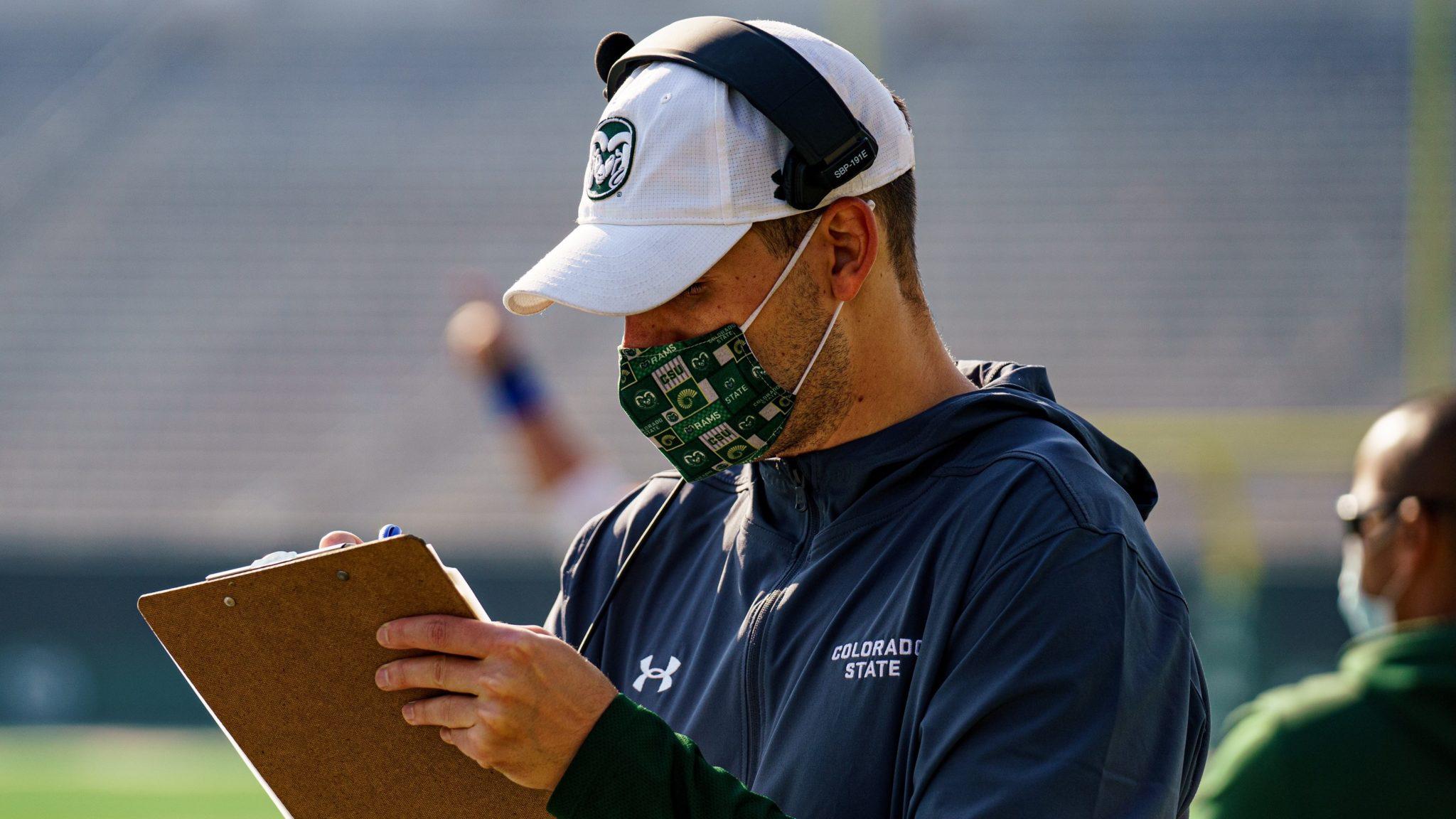 Coach wearing mask